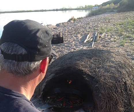 Blair Lebsack (RgeRd, pictured), Brayden Kozak, Alessandro Porcelli and videographer/outdoorsman Kevin Kossowan went to the island early to build the mud oven and the grills.