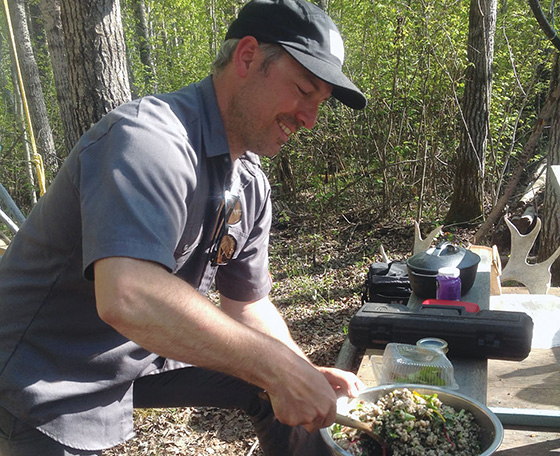 Blair Lebsack prepares salad at the Cook It Raw event held this summer at Lac la Biche